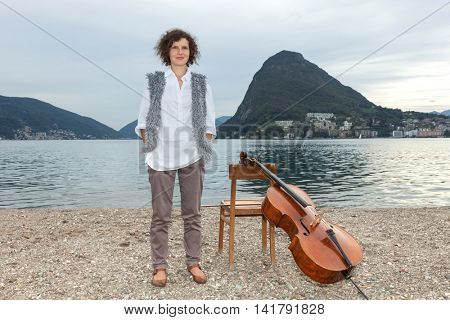 beautiful girl with the cello at the seaside
