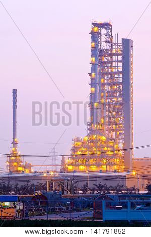 Distillation tower at Oil Refinery Plant at morning twilight