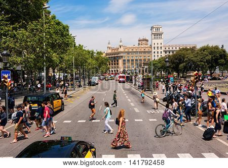 Barcelona Spain - June 6 2016: People fill the busy Catalonia Square in Barcelona.The plaza covers an area of about 50000 square metres. It is especially known for its fountains and statues.