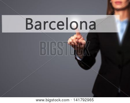 Barcelona - Female Touching Virtual Button.