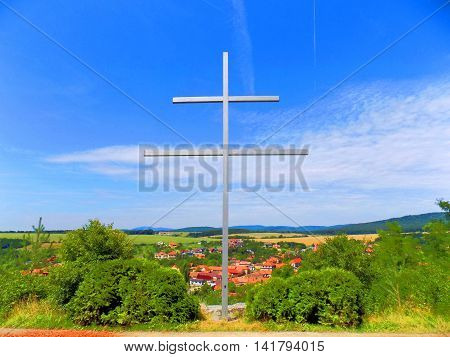 Double cross (Slovak national symbol) in front of village