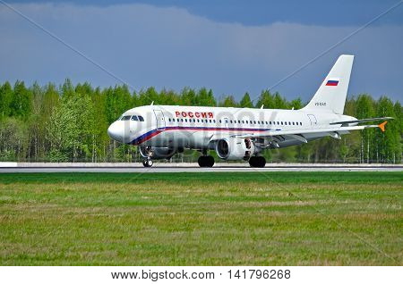 SAINT PETERSBURG RUSSIA - MAY 11 2016. Rossiya Airlines Airbus A319 airplane. Airplane rides on the runway. Rossiya airplane closeup. Rossiya Airlines is a Russian airline in Saint Petersburg