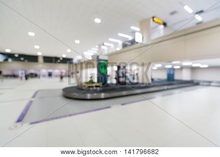 Blurred bokeh background of baggage claim belt area in arrival zone of an airport