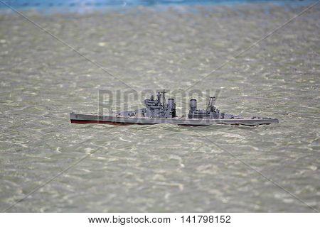 Model warship in the pool. Ship modeling