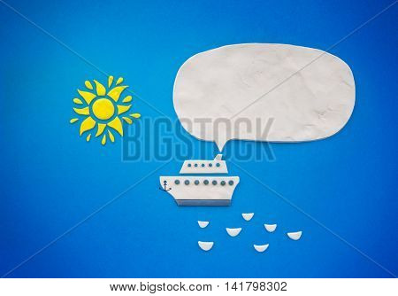 White ship with bubble speech and sun on a blue background, illustration created from plasticine.