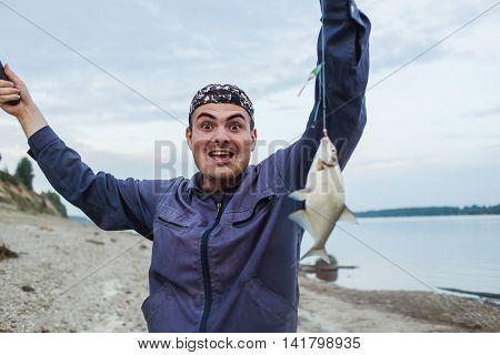 The fisherman has hooked fish. Fresh-caught bream.