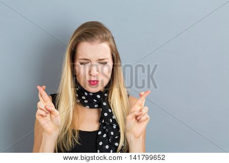 Young Woman Wishing For Good Luck