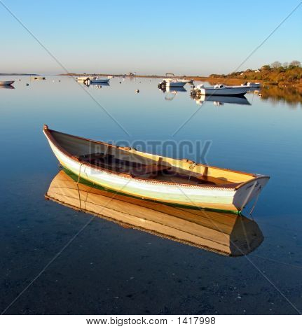 A Row Boat Casts A Crisp Reflection At Stage Harbor, Massachusetts