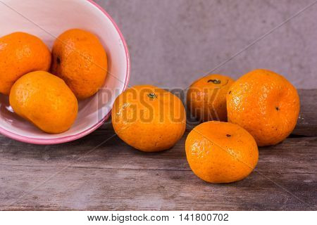 Still life with mandarins orange in cup