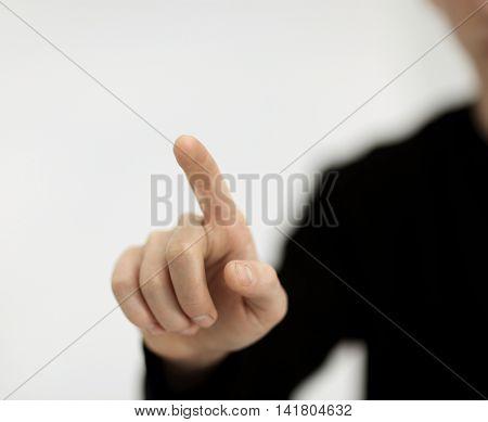 Businessman pressing a virtual button