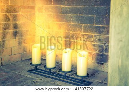 Fireplace with decorative candles  ( Filtered image processed vintage effect. )
