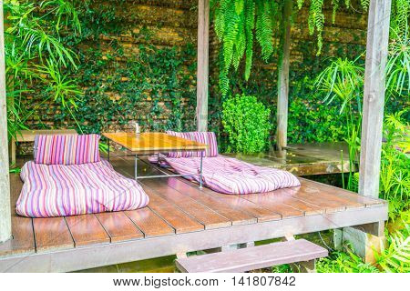 Relaxation space in garden with beds