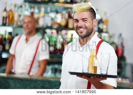 waiter portrait standing near bartender desk in restaurant bar