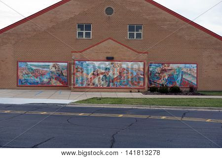 JOLIET, ILLINOIS / UNITED STATES - NOVEMBER 29, 2015: Three murals, created by Kathleen McKinney in 2004, decorate the exterior of the Wesmere Elementary School