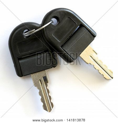 Two black and silver filing cabinet keys.