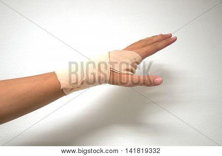 white medicine bandage on injury hand, man