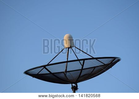 A Satellite dish on clear sky background.