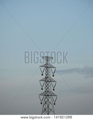 A powerlines tower with clear sky background.