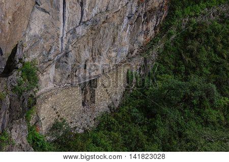 Inca Bridge In Machu Picchu In Peru. Unesco World Heritage Site