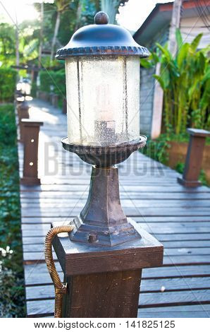 lantern in a garden on the wood bridge