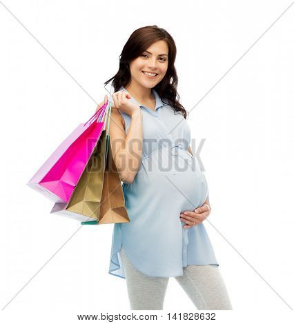pregnancy, sale, motherhood, people and expectation concept - happy pregnant woman with shopping bags touching her big belly over white background