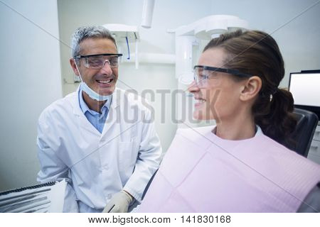 Dentist interacting with patient in dental clinic
