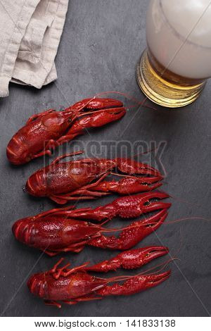 Boiled crayfish and a glass of beer