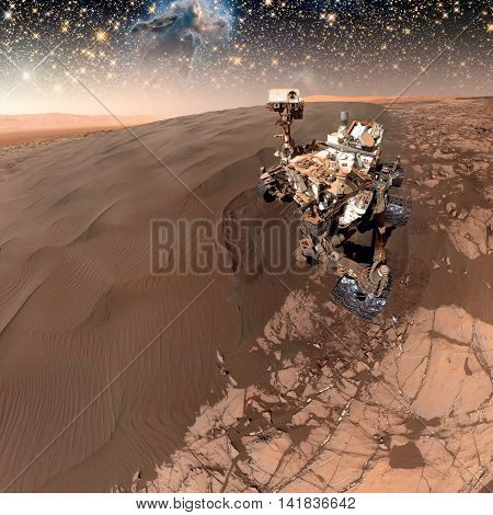 Curiosity rover exploring the surface of Mars. Retouched image. Elements of this image furnished by NASA.