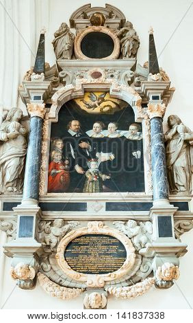 Odense Denmark - July 21 2015: The painting of a noble familt in the gothic St. Canute's Cathedral