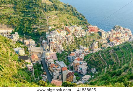 A view of the colorful traditional houses on the rock. The coast of Liguria. Manarola, Cinque Terre.