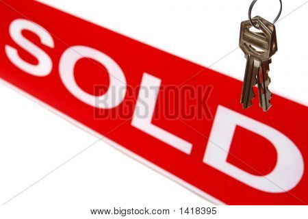 Real Estate House Keys and Sold Sign