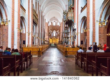Roskilde Denmark - July 23 2015: People in the nave of the medieval Cathedral