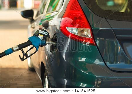 Car refueling on a petrol station closeup