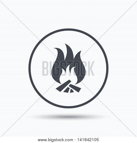Fire icon. Blazing bonfire flame symbol. Circle button with flat web icon on white background. Vector