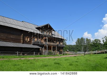 Big wooden village house. The monument of wooden architecture. St. Petersburg Russia