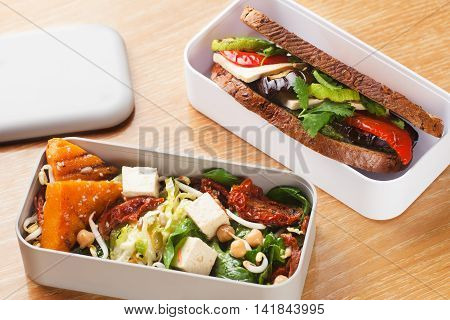 Lunchbox salad with pumpkin chickpeas and a sandwich with grilled vegetables from fresh