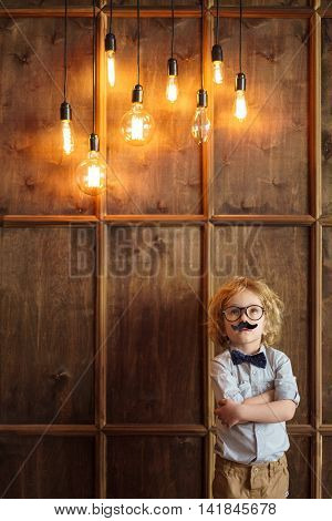 Little boy at the wall with lights
