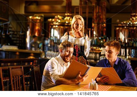 Young men and woman in a pub