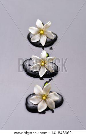 Three gardenia with therapy stones