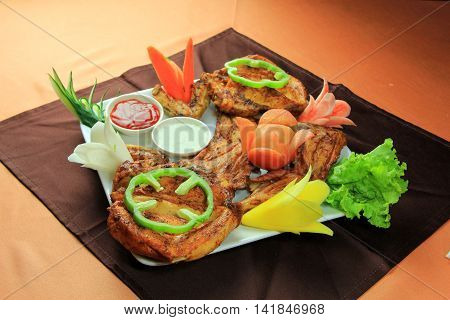 Delicious fried boneless chicken with chili lettuce and sauce