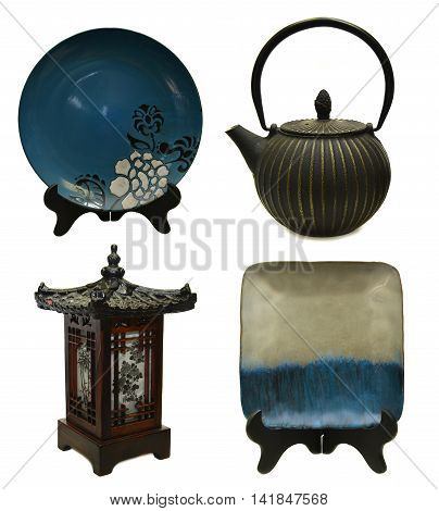 Design set with japanese culture objects: metal tea pot, decorated ceramic plates and wooden lantern