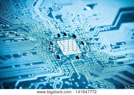 blue printed circuit board closeup background of science and technology