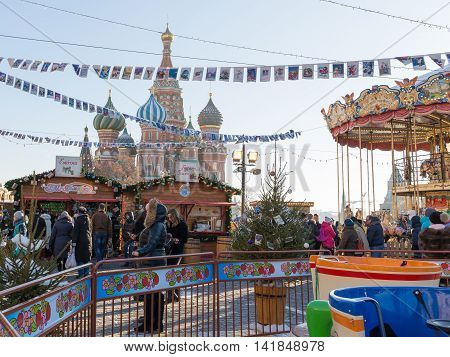Moscow - November 29 2015: Christmas Market in the Red Square and a lot of people walking in the Christmas holidays St. Basil's Cathedral and Christmas decorations November 29 2016 Moscow Russia
