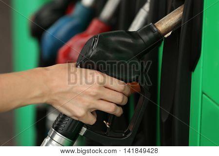 Green pistols on fuel station