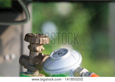 Barbeceue gas bottle closeup with presure indicator