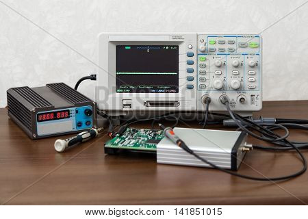 The oscilloscope for the measurement and control electronic signals on the engineer's workplace