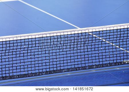 Table tennis net with blue table with net