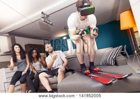 Group Of Friends Having Fun At Home Skiing Using Viewer For Virtual Reality