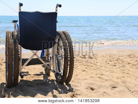 Wheelchair Equipped With Special Tires To Go To The Beach