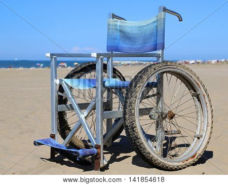 Modern Wheelchair In Aluminum With Special Wheels To Move Around